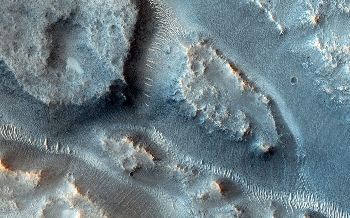 Many valleys occur all over Mars that reveal an extensive ancient history of liquid water erosion. This image from NASA's Mars Reconnaissance Orbiter shows a complex valley network near Idaeus Fossae.