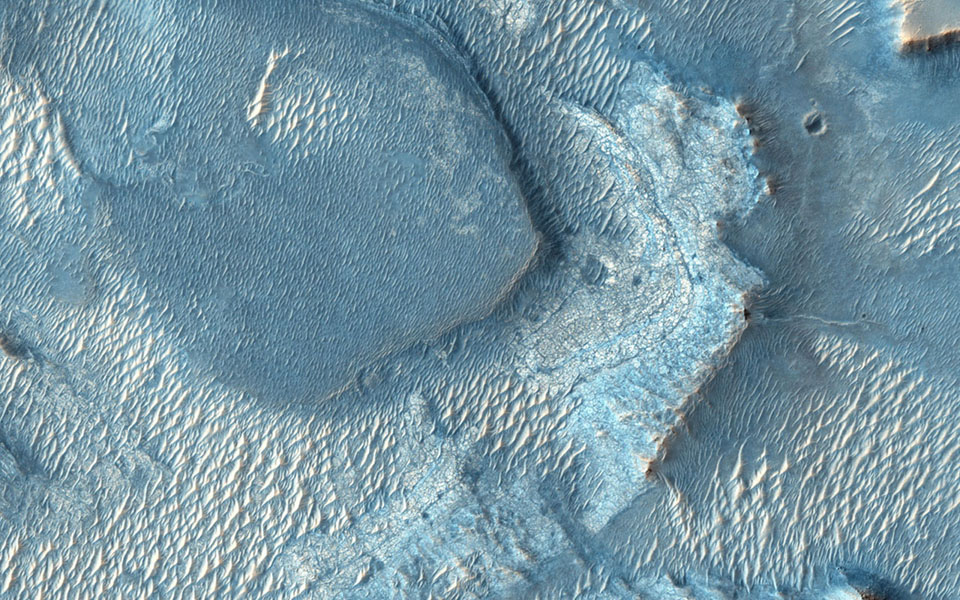 Nili Fossae, once considered a potential landing spot for the Mars Science Laboratory, has one of the largest, most diverse exposures of clay minerals as seen by NASA's Mars Reconnaissance Orbiter.