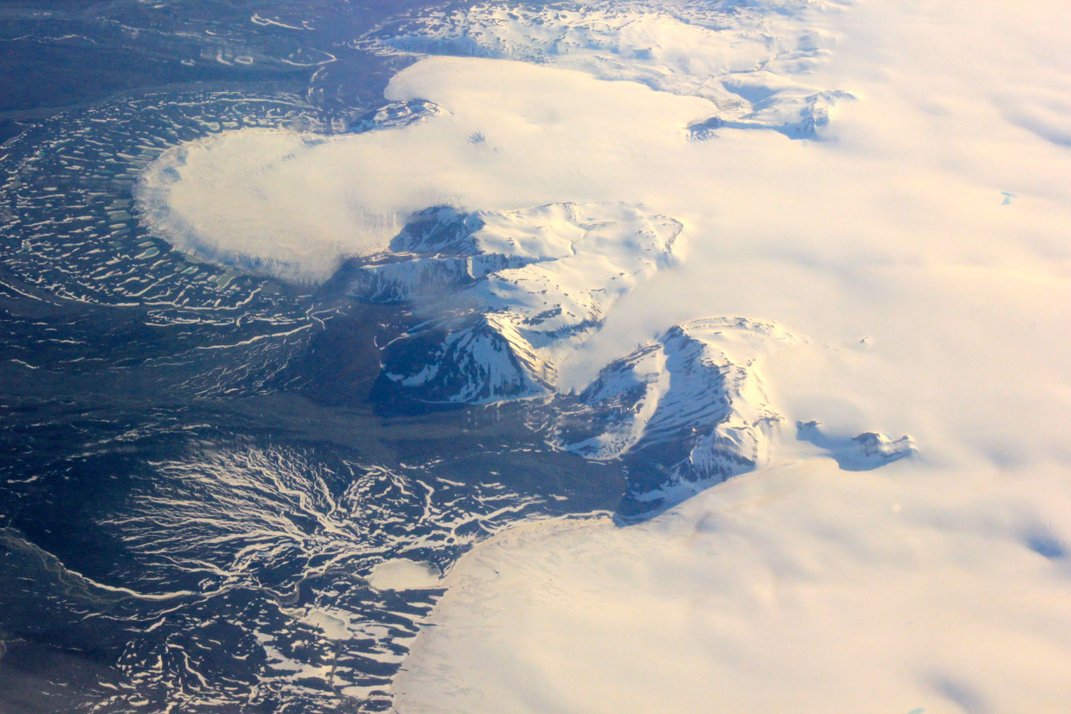 This image shows a small part of the Hofsjökull ice cap in Iceland, which encompasses several glaciers. The fan at upper left is part of a glacier called Mûlajökul.