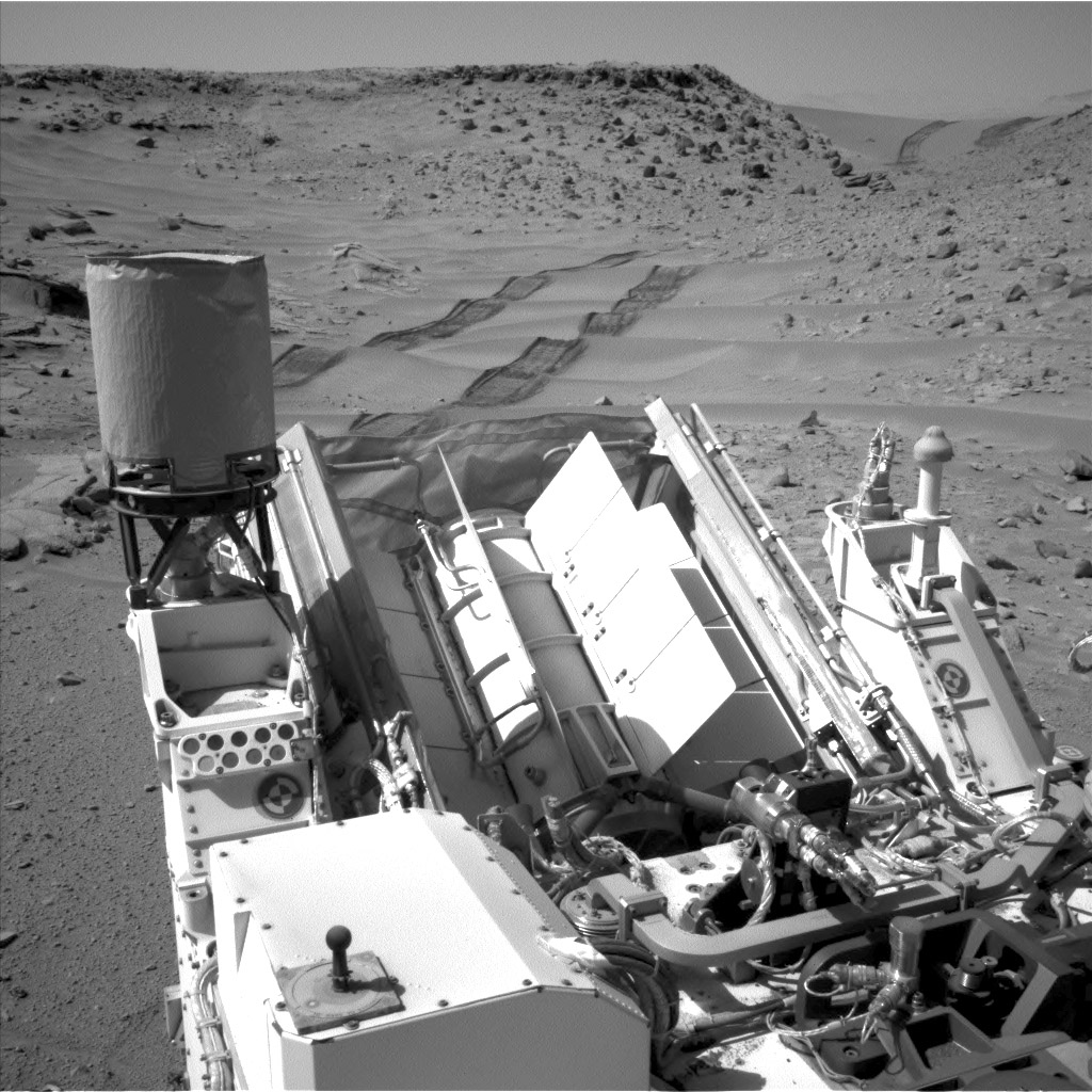 NASA's Curiosity Mars rover used the Navigation Camera (Navcam) on its mast to catch this look-back eastward at wheel tracks from driving through and past 'Dingo Gap' inside Gale Crater.
