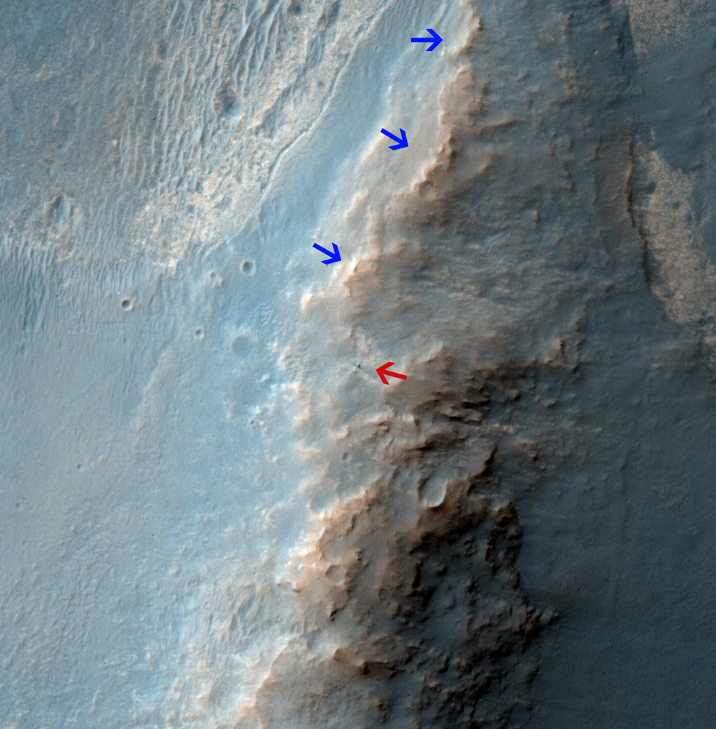 NASA's Mars Reconnaissance Orbiter caught this view of NASA's Mars Exploration Rover Opportunity on Feb. 14, 2014. The red arrow points to Opportunity at the center of the image. Blue arrows point to tracks left by the rover in October 2013.