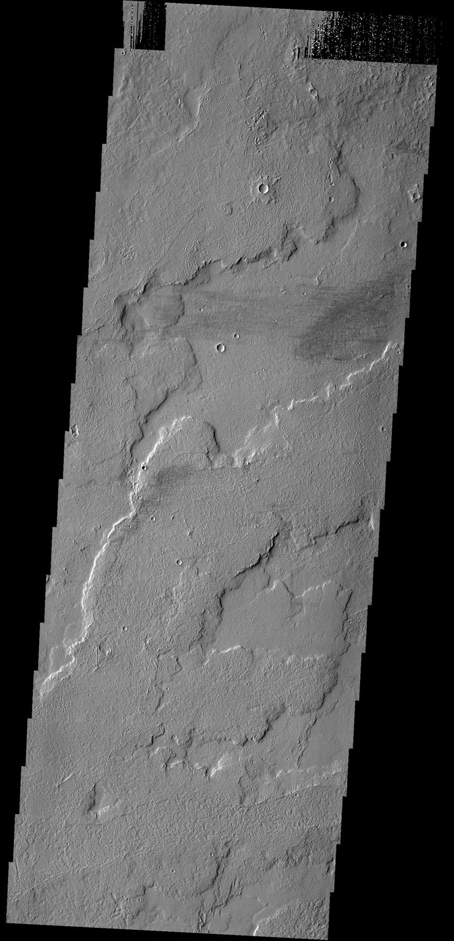 This image shows a small portion of the extensive lava flows created by the large Tharsis volcanoes as seen by NASA's 2001 Mars Odyssey spacecraft. These flows are located north east of Ascraeus Mons.