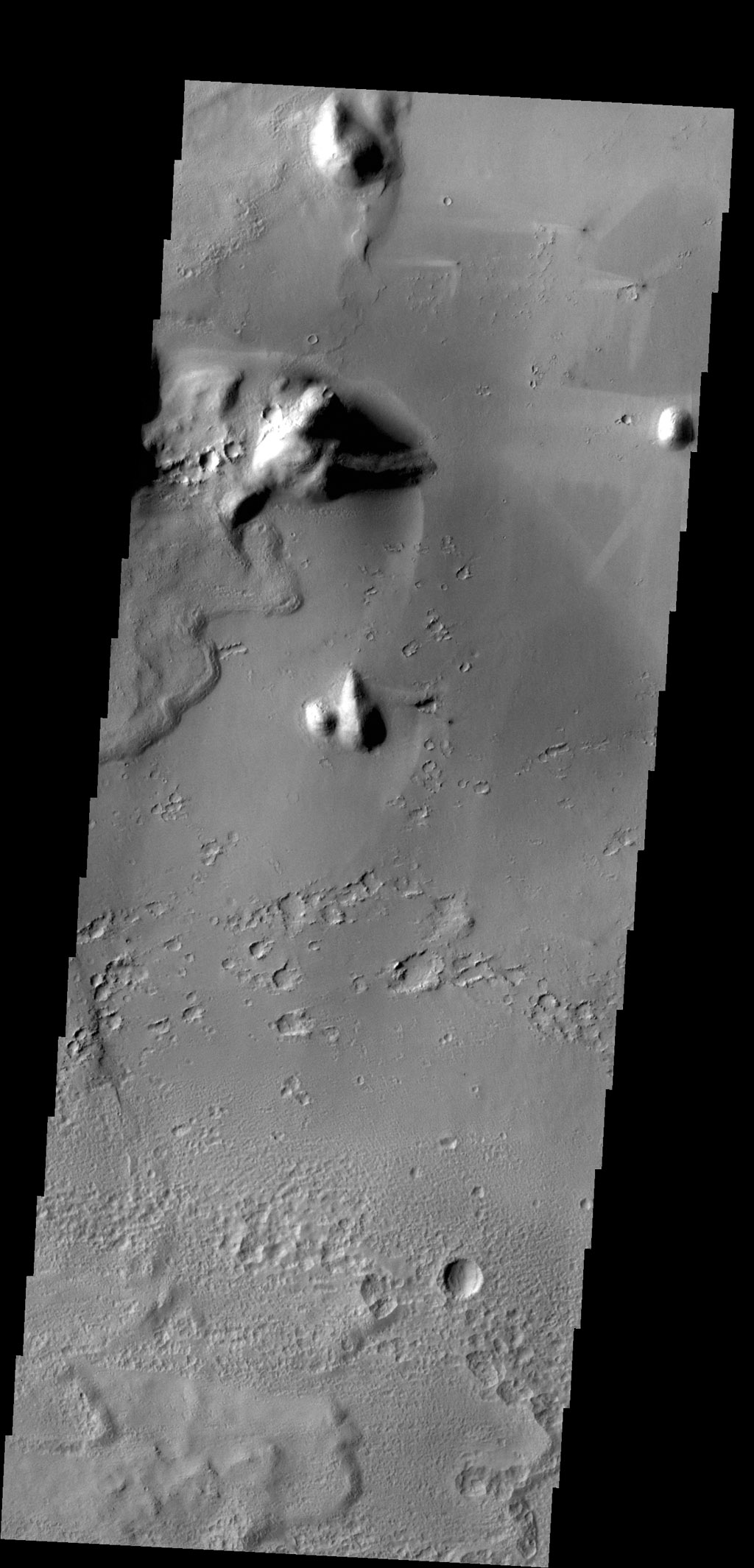 Bright windstreaks are located around several small craters at the top of this image captured by NASA's 2001 Mars Odyssey spacecraft.