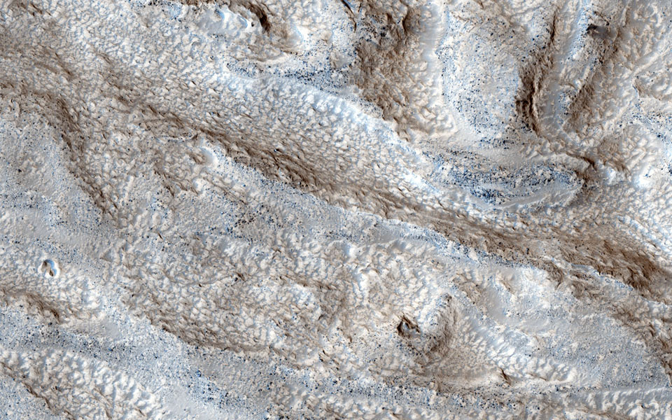 The objective of this observation from NASA's Mars Reconnaissance Orbiter is to determine the nature of a group of what appears to be channels that trend in a west-east direction.