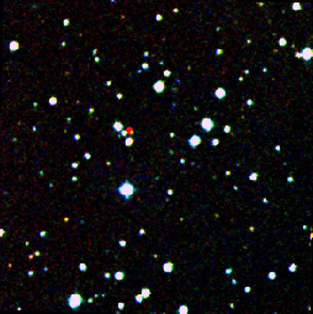 A nearby star, called WISEA J204027.30+695924, stands out in red in this image from the Second Generation Digitized Sky Survey.