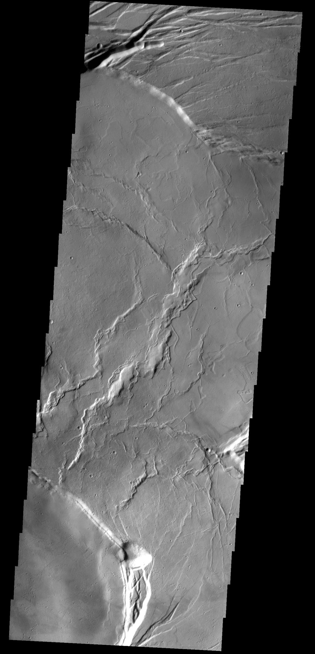 This image from NASA's 2001 Mars Odyssey shows the central portion of the complex caldera at the summit of Olympus Mons.