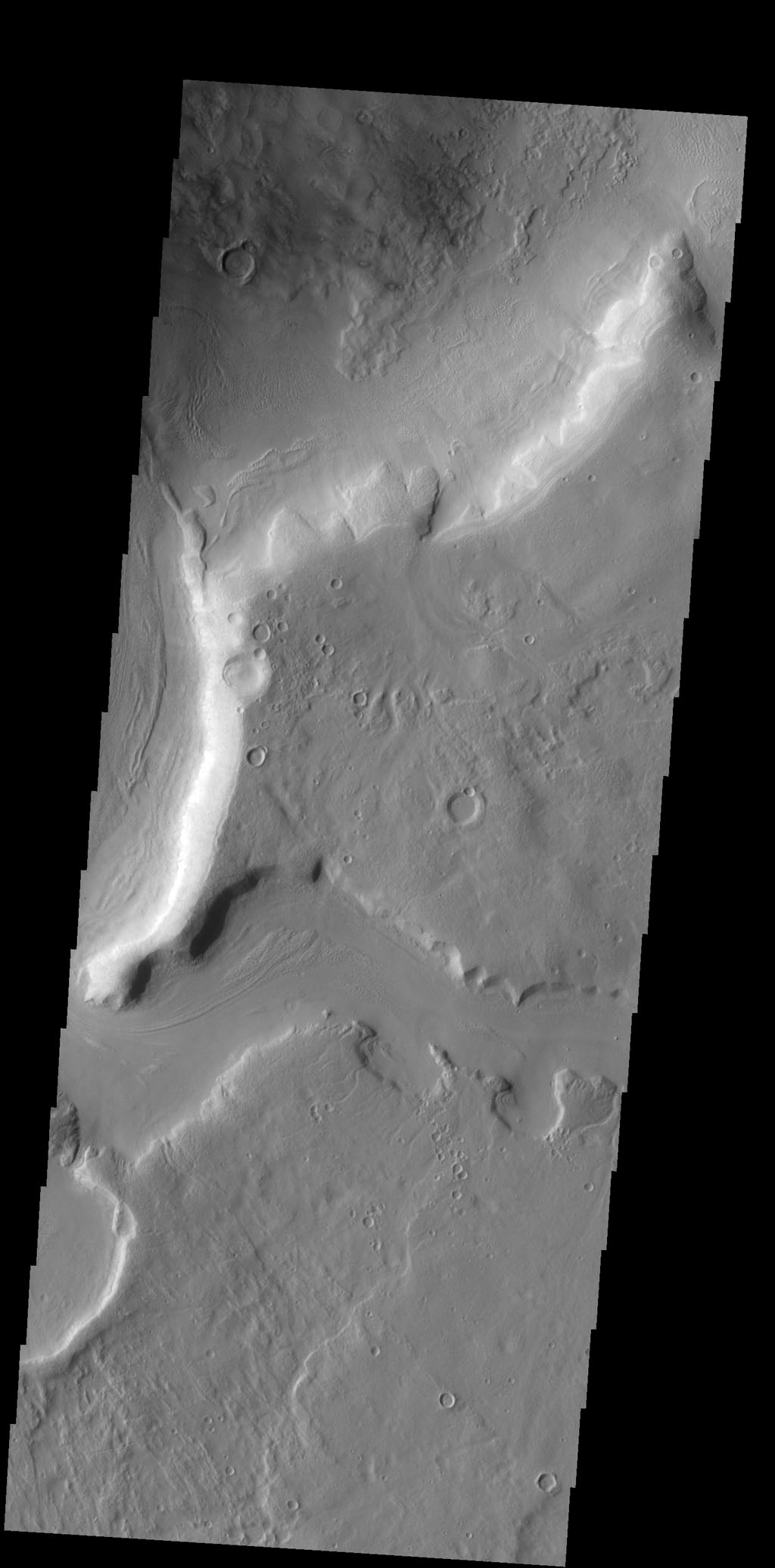 This image captured by NASA's 2001 Mars Odyssey spacecraft shows a portion of one of the numerous channels that dissect the northern margin of Arabia Terra.