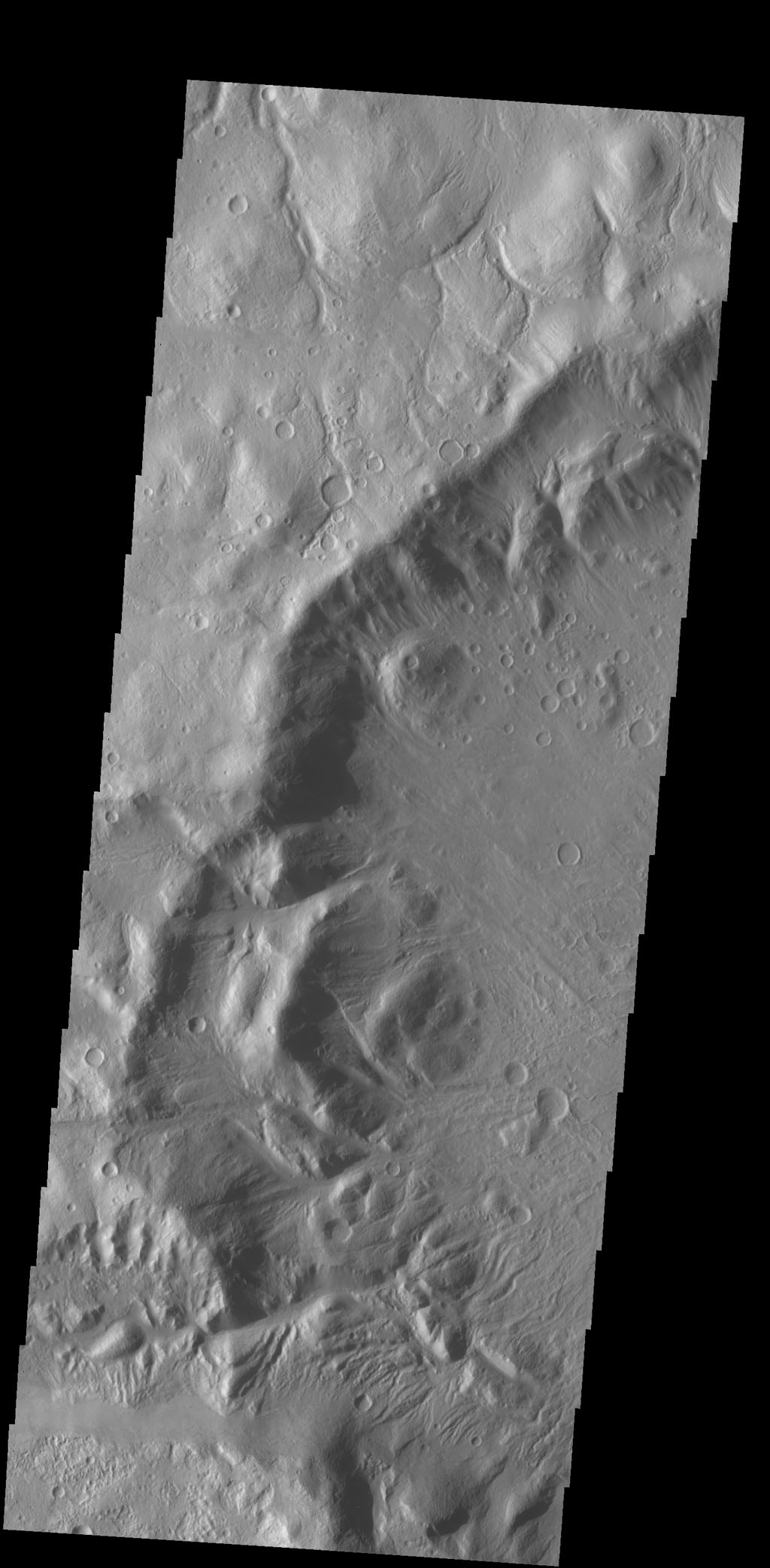 Numerous channels dissect the rim of this large crater located on Acheron Fossae as seen by NASA's 2001 Mars Odyssey spacecraft.
