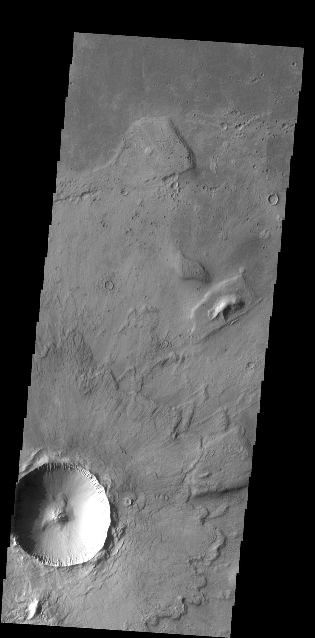 Multiple overlapping lobes of ejecta are visible in this image of an unnamed crater in Chryse Planitia as seen by NASA's 2001 Mars Odyssey spacecraft.