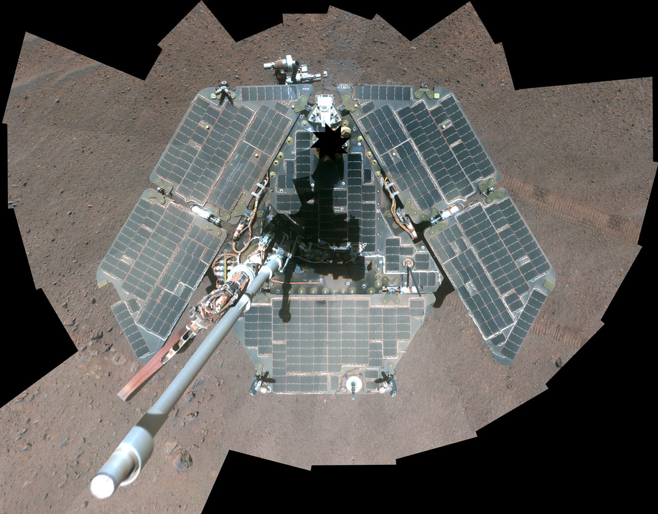 A false-color self-portrait of NASA's Mars Exploration Rover Opportunity taken by the rover's panoramic camera (Pancam) shows effects of recent winds removing much of the dust from the solar arrays.