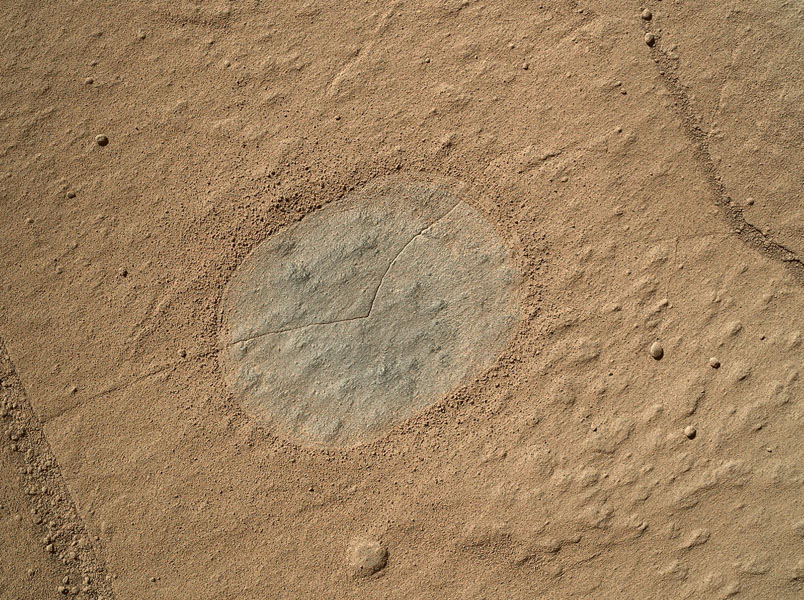 This image from an animation shows a patch of sandstone scrubbed with the Dust Removal Tool, a wire-bristle brush, on NASA's Curiosity Mars rover. This rock target is called 'Windjana,' after a gorge in Western Australia.