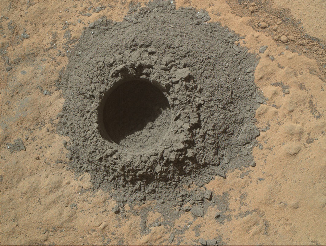 NASA's Curiosity Mars rover completed a shallow 'mini drill' test April 29, 2014, in preparation for full-depth drilling at a rock target called 'Windjana.' The hole results from the test is 0.63 inch across and about 0.8 inch deep.