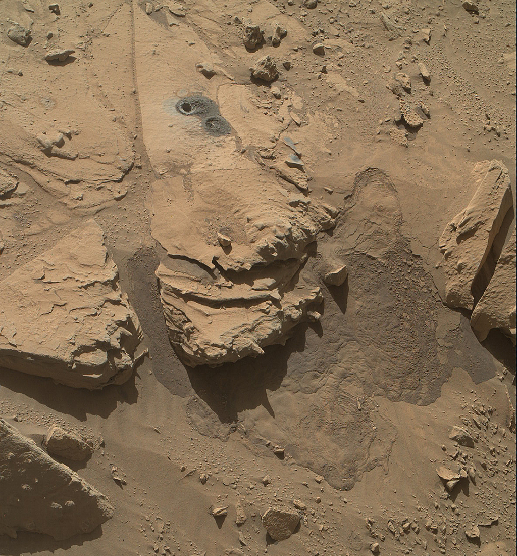 This May 12, 2014, view from NASA's Curiosity Mars Rover shows the rock target 'Windjana' and its immediate surroundings after inspection of the site by the rover by drilling and other activities.
