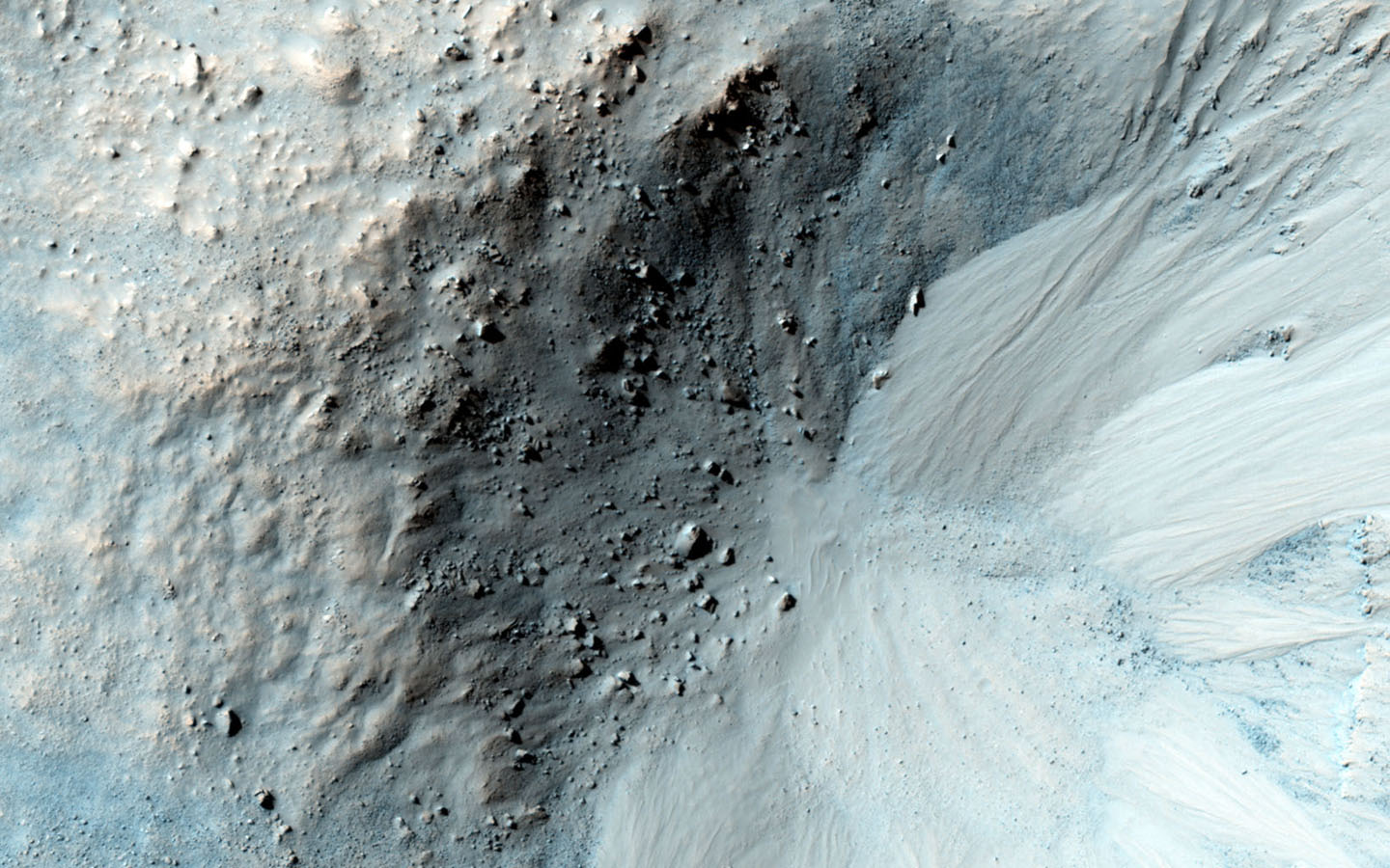 This impact crater in the region of Mars called Libya Montes, observed by NASA's Mars Reconnaissance Orbiter, shows typical gullies with alcoves at the top, channels, and depositional fans at the bottom.