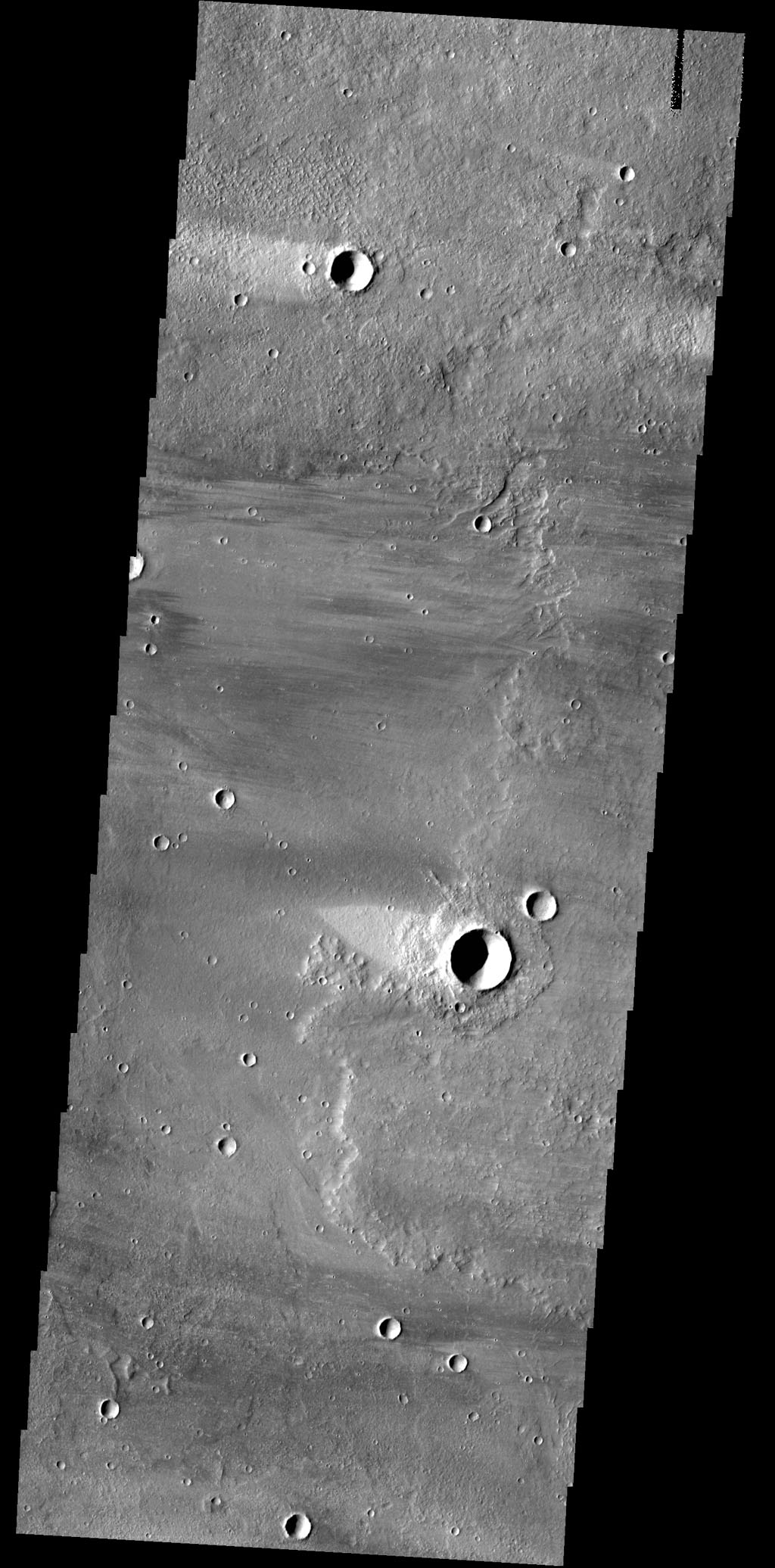 This image captured by NASA's 2001 Mars Odyssey spacecraft shows windstreaks on the volcanic surface between Alba Mons and Acheron Fossae.