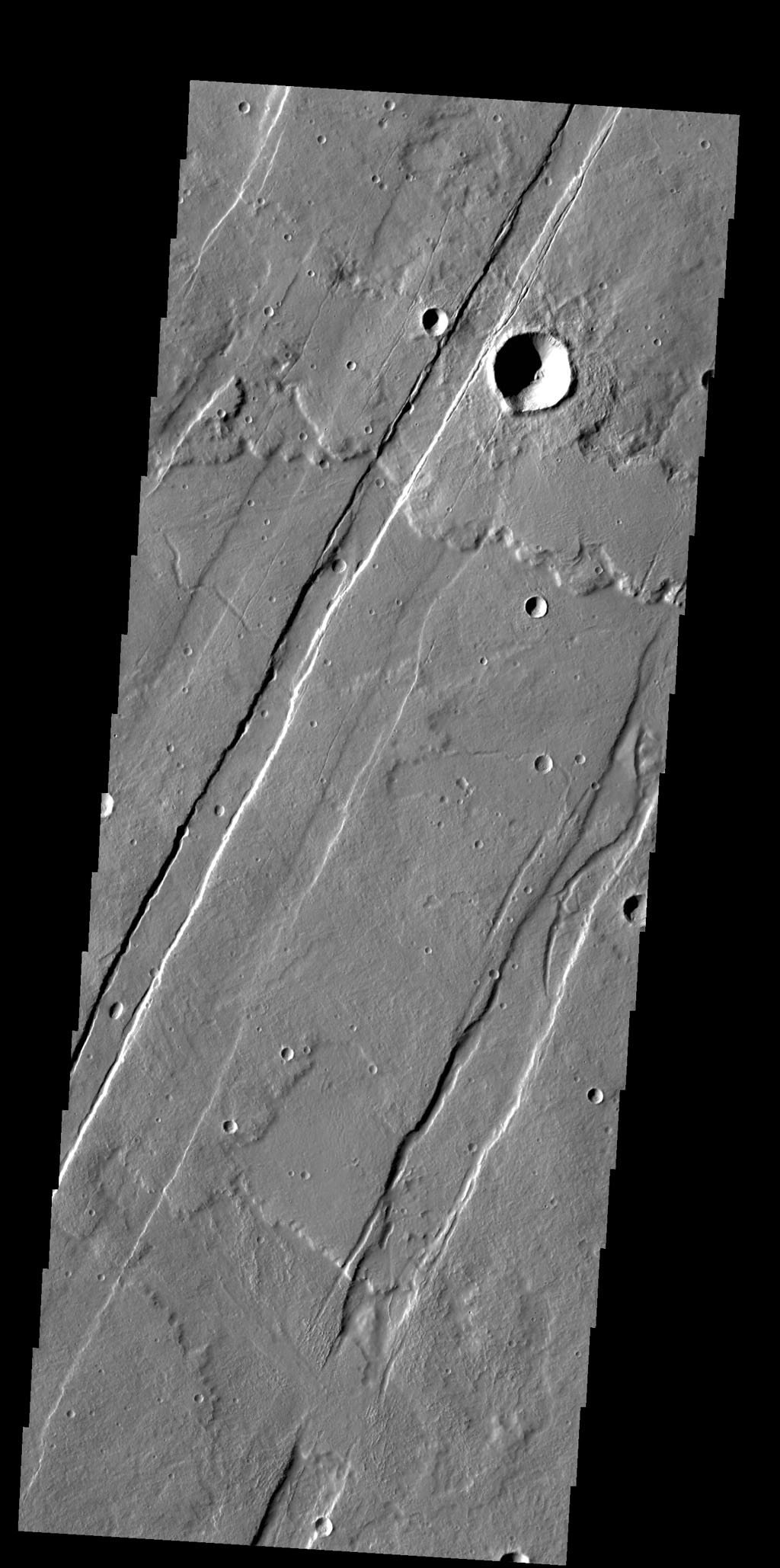 This image captured by NASA's 2001 Mars Odyssey spacecraft shows several of the graben (fault bounded depression) that are part of Acheron Catena.