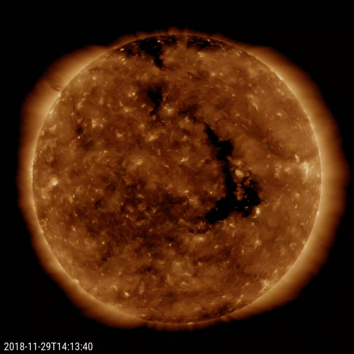 NASAs Solar Dynamics Observatory shows a long-lasting coronal hole has again rotated around to face the Earth (Nov. 28-30, 2018).