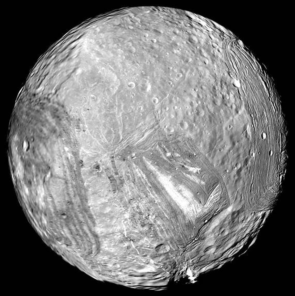 Uranus' icy moon Miranda is seen in this image from Voyager 2 on January 24, 1986.