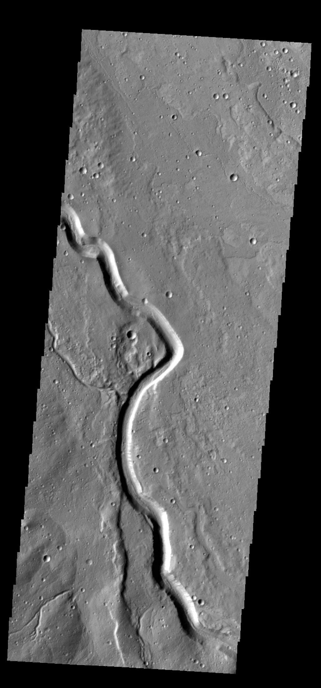 This image captured by NASA's 2001 Mars Odyssey spacecraft shows part of Buvinda Vallis, located just outside the northeastern flank of Hecates Tholus.
