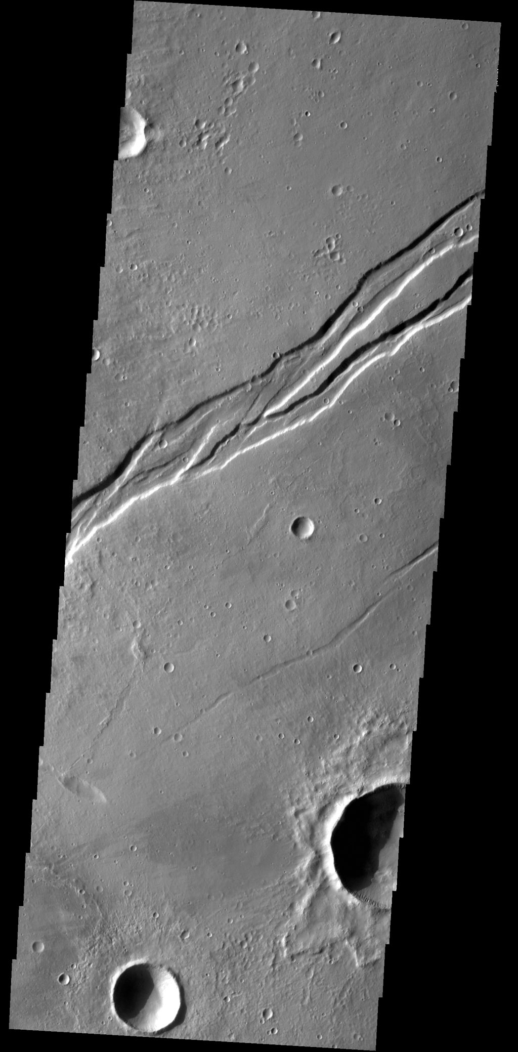 This complex graben is part of Labeatis Fossae. This image was captured by NASA's 2001 Mars Odyssey spacecraft.