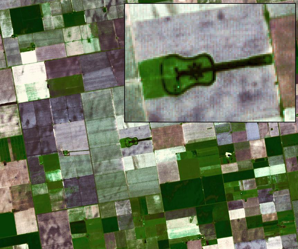 Located in the fertile agricultural region of Argentina's Pampas is a guitar-shaped forest made up of cypress and eucalyptus trees as seen by NASA's Terra spacecraft.
