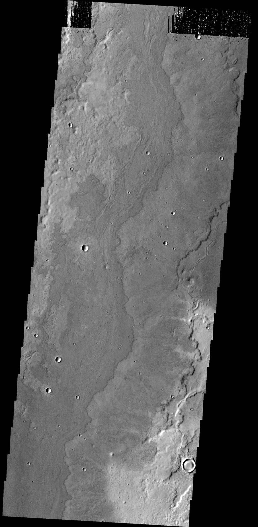 The lava flows in this image captured by NASA's 2001 Mars Odyssey spacecraft are located SE of Adams Crater.