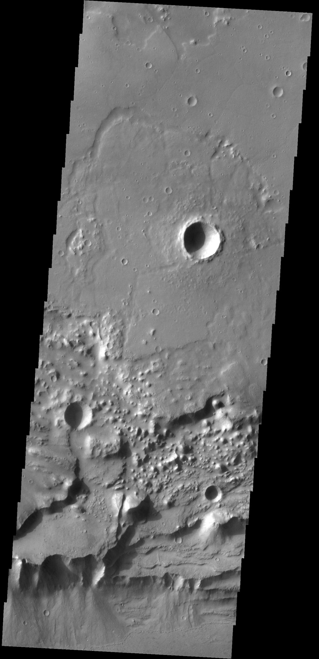 Triangular shaped deposits at cliff edges are termed alluvial fans. Alluvial fans typically form in arid regions were water flow is limited, so deposits of material are not washed away as seen by NASA's 2001 Mars Odyssey spacecraft.