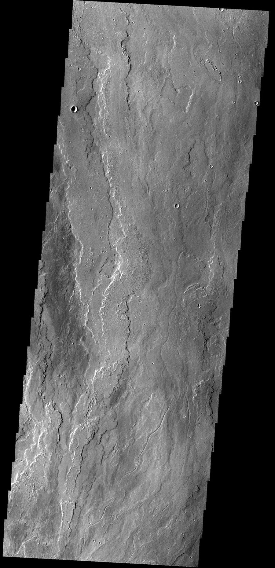 The lava flows in this image from NASA's 2001 Mars Odyssey spacecraft are located east of Olympus Mons.