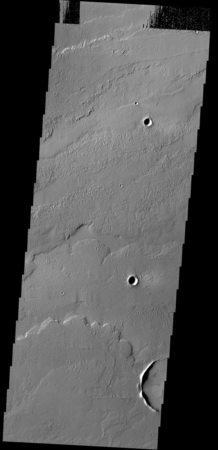 This image captured by NASA's 2001 Mars Odyssey spacecraft shows some of the lava flows located east of the large Tharsis volcanoes.