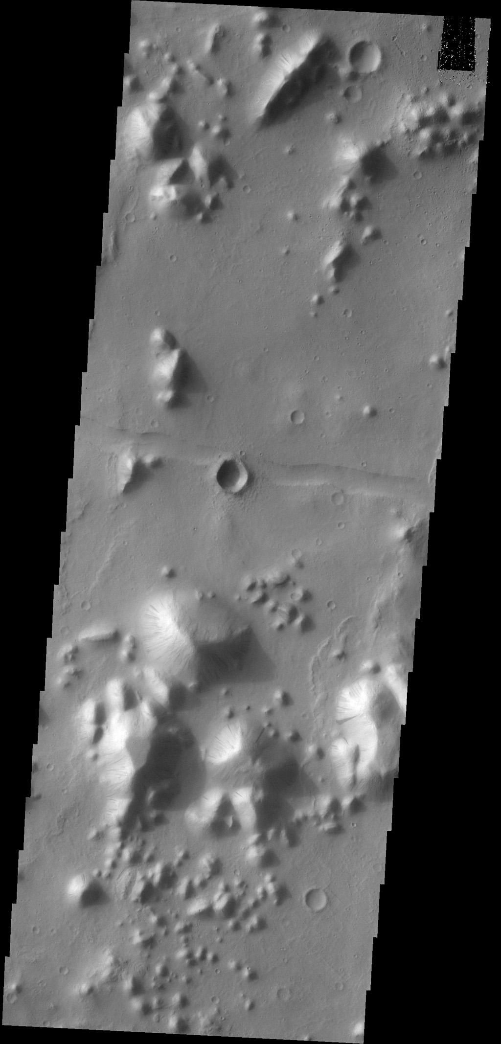 Dark slope streaks mark many of the hills in this image captured by NASA's 2001 Mars Odyssey spacecraft. This region of hills is called Tartarus Colles. The term colles means small hills or knobs.
