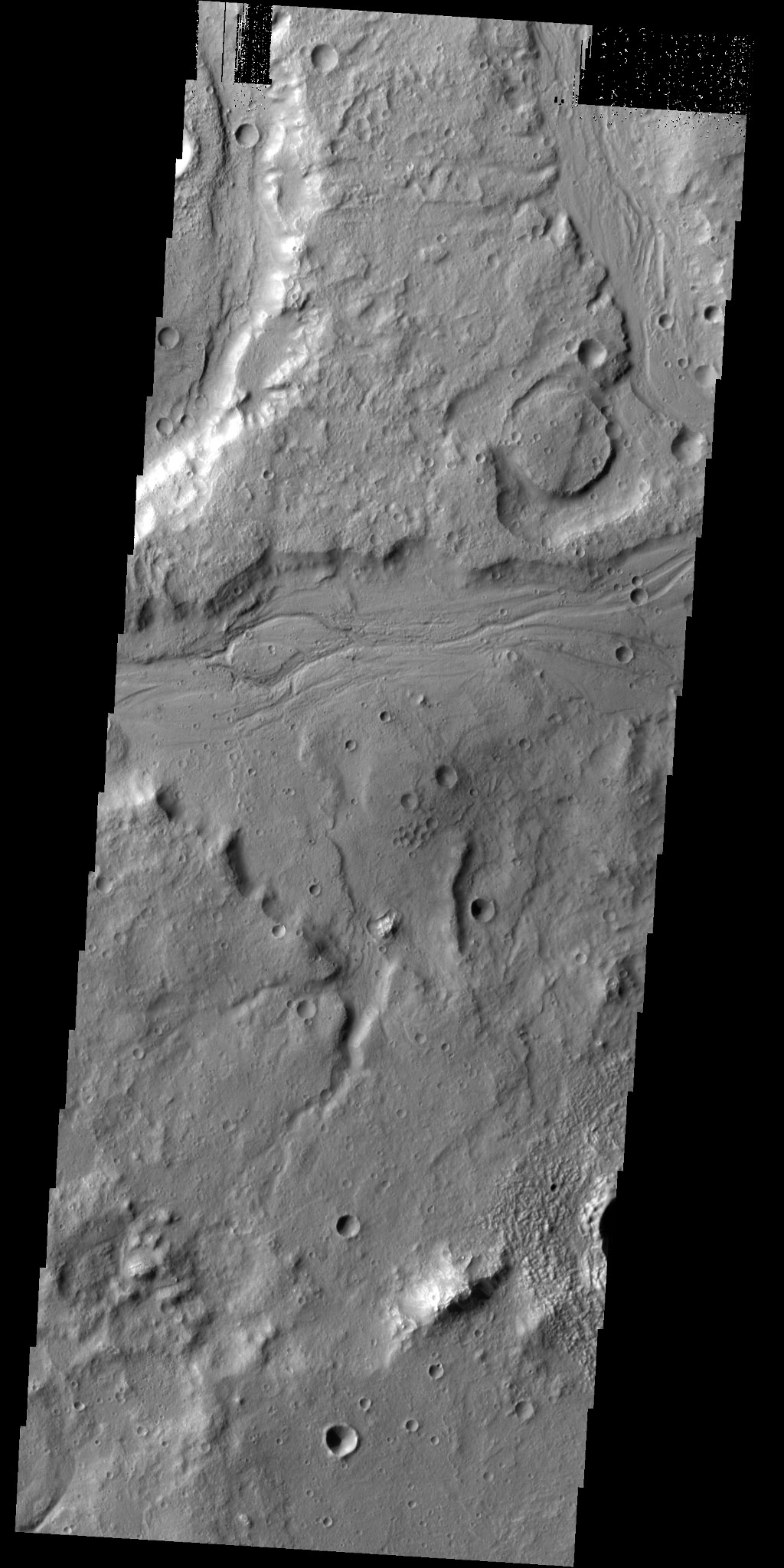 Numerous unnamed channels seen in this image captured by NASA's 2001 Mars Odyssey spacecraft are located on the eastern margin of Tempe Terra.