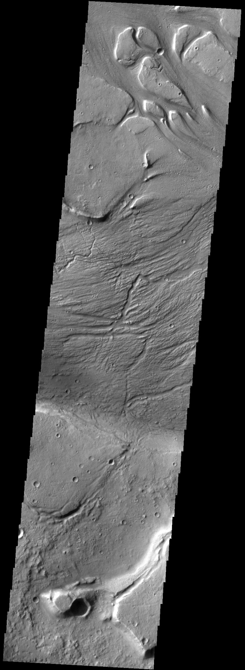 There are several streamlined islands in this image of Kasei Valles. This image captured by NASA's 2001 Mars Odyssey spacecraft is located near the region where Kasei Valles empties into Chryse Planitia.