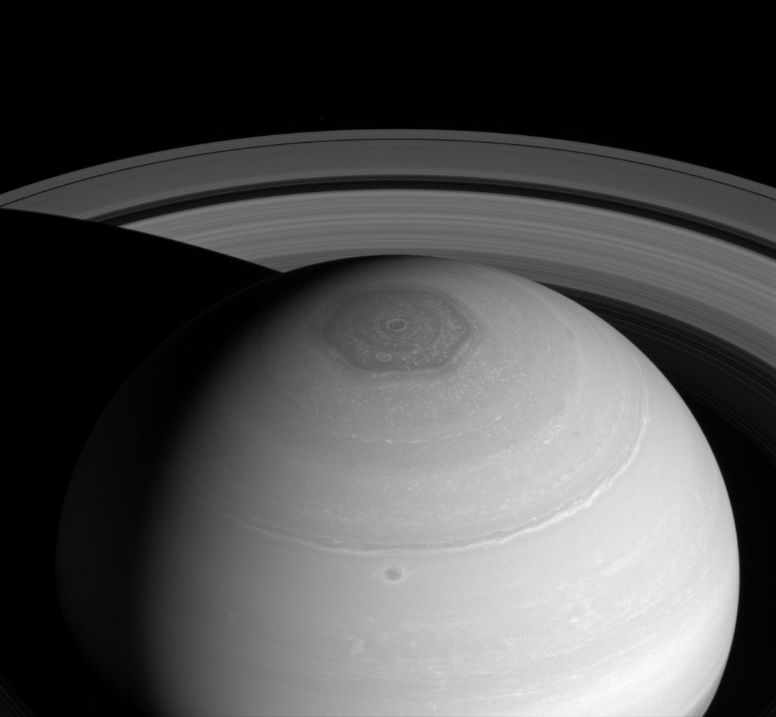 NASA's Cassini spacecraft captures three magnificent sights at once: Saturn's north polar vortex and hexagon along with its expansive rings.
