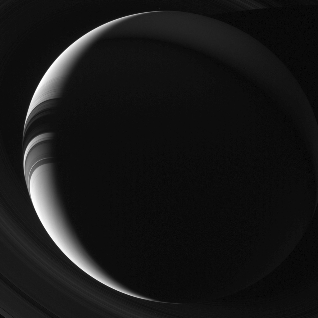 Saturn appears to NASA's Cassini's cameras as a thin, sunlit crescent in this unearthly view. Citizens of Earth, being so much closer to the Sun than Saturn, never get to enjoy a view of Saturn like this without the aid of our robot envoys.