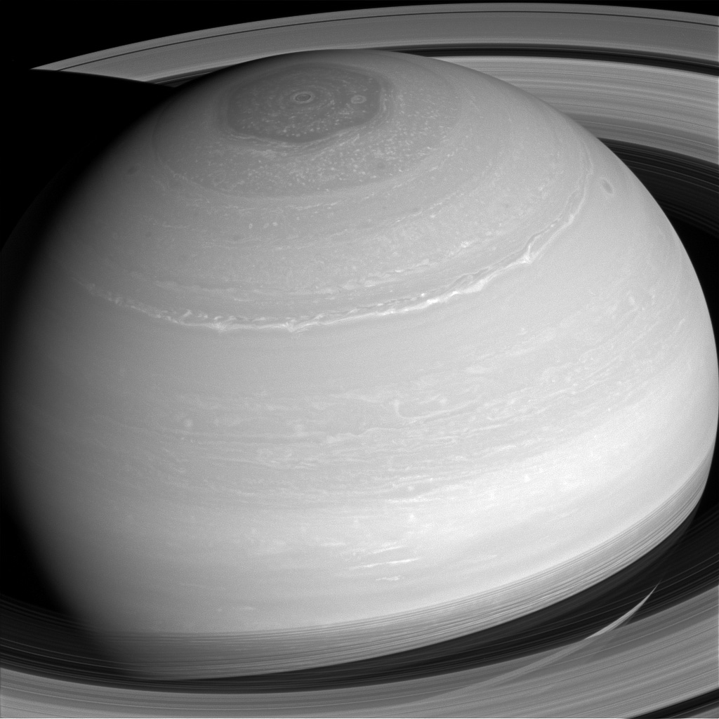Saturn's many cloud patterns, swept along by high-speed winds, look as if they were painted on by some eager alien artist in this image from NASA's Cassini spacecraft.