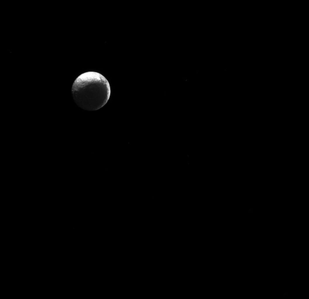 The moon Iapetus, like the 'force' in Star Wars, has both a light side and a dark side. Scientists think that Iapetus' dark/light asymmetry was actually created by material migrating away from the dark side.
