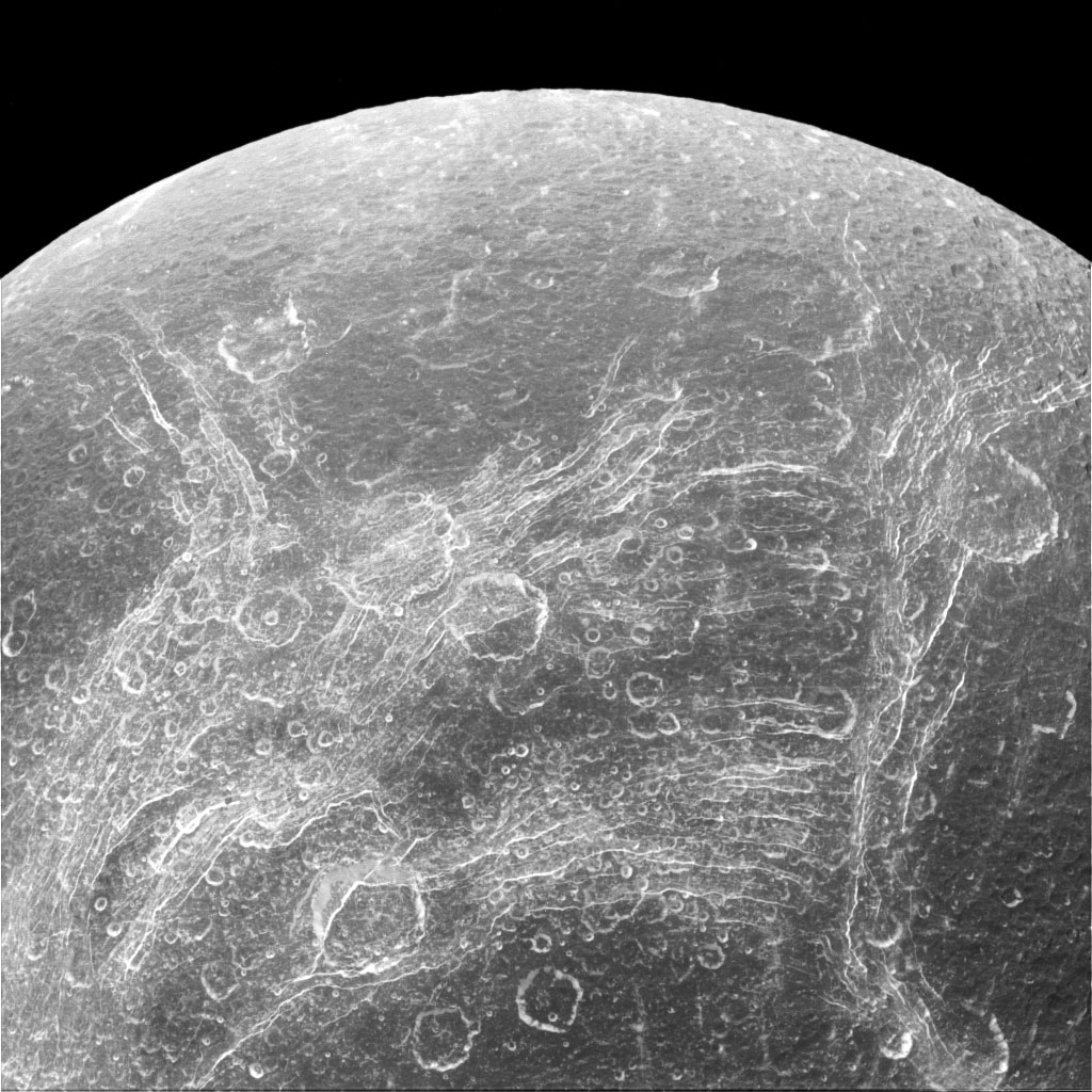 Some parts Dione's surface are covered by linear features, called chasmata, which provide dramatic contrast to the round impact craters that typically cover moons. This image was captured by NASA's Cassini spacecraft.