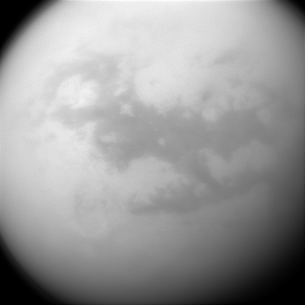 NASA's Cassini spacecraft views the dunelands of Saturn's frigid moon Titan. The dark, H-shaped area seen here contains two of the dune-filled regions, Fensal (in the north) and Aztlan (to the south).