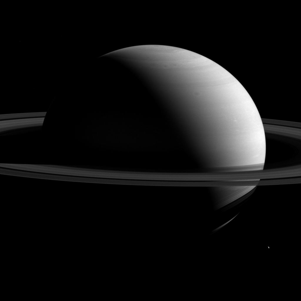 NASA's Cassini spacecraft captured Saturn, around 10 times the diameter of Earth, dwarfs it retinue of moons. Tethys is seen here at lower right.