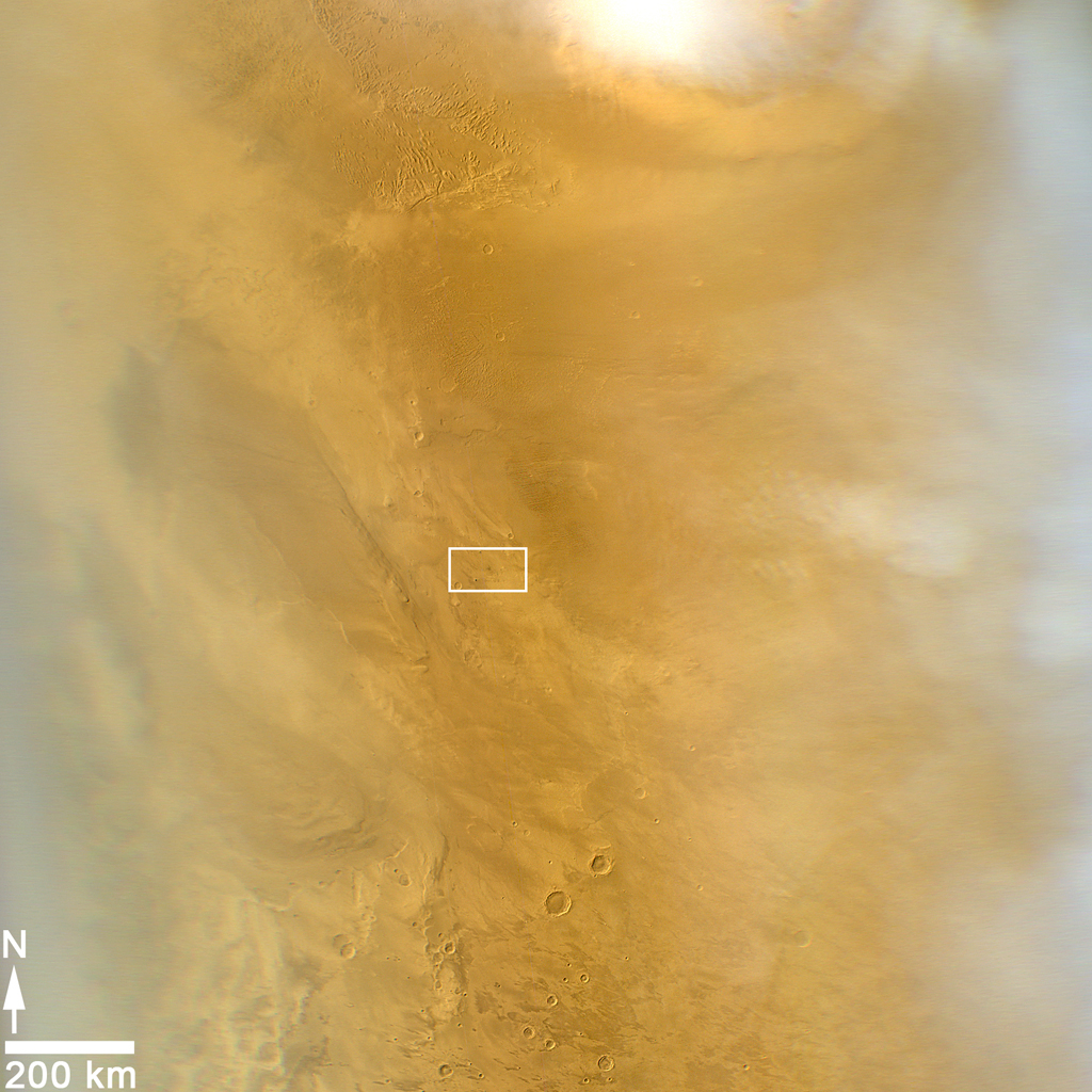This March 20, 2014, image from the MARCI camera on NASA's Mars Reconnaissance Orbiter has a dark spot (at center of rectangle) noticed while the image was being examined for a weather report.