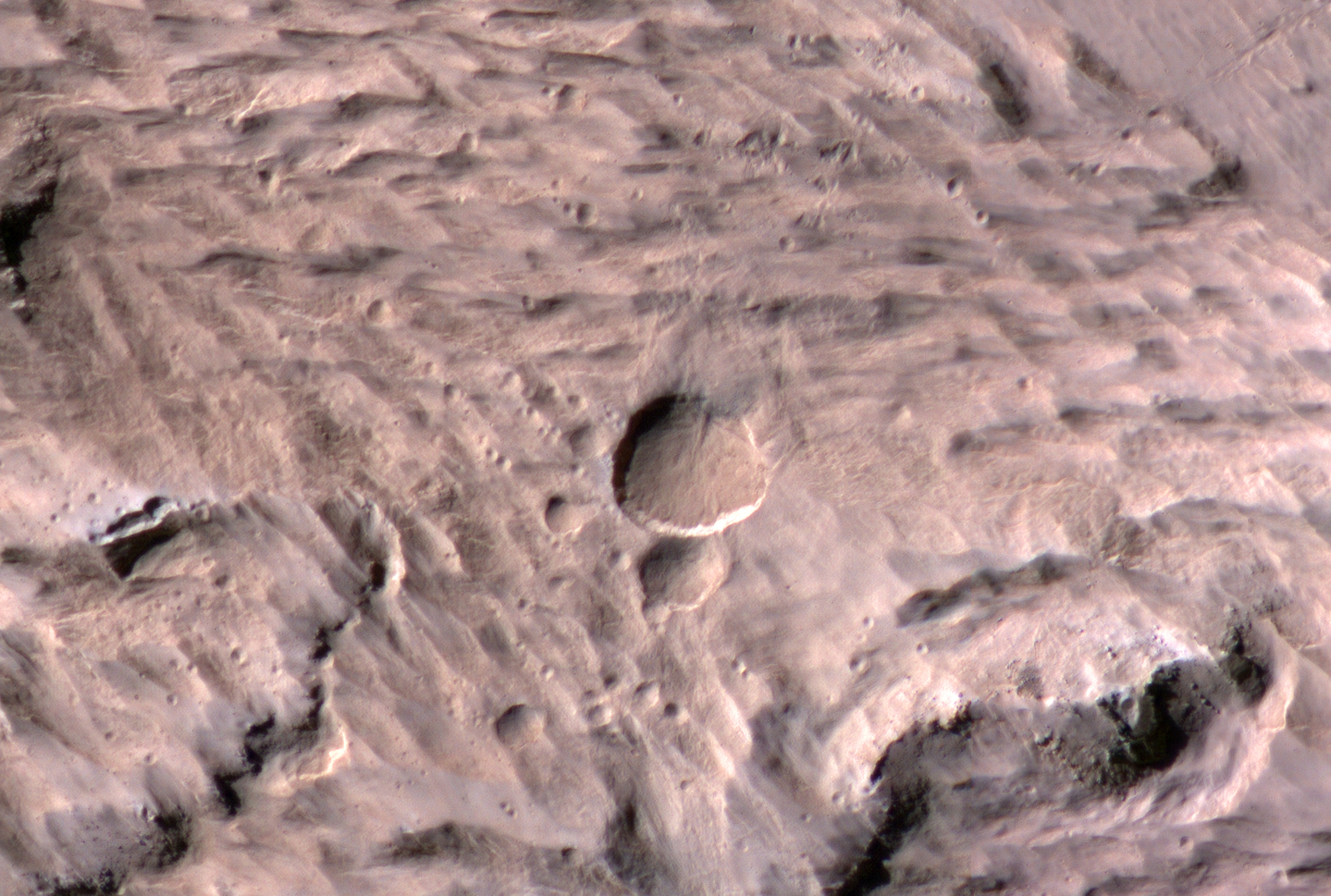 The largest crater associated with a March 2012 impact on Mars has many smaller craters around it, revealed in this image from the High Resolution Imaging Science Experiment (HiRISE) camera on NASA's Mars Reconnaissance Orbiter.