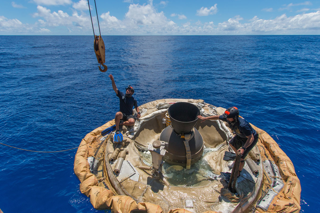 Divers retrieve the test vehicle for NASA's Low-Density Supersonic Decelerator off the coast of the U.S. Navy's Pacific Missile Range Facility in Kauai, Hawaii.