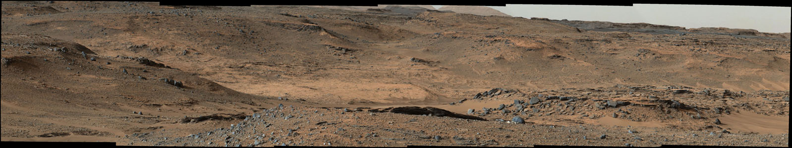 This image from NASA's Mars Curiosity rover shows the 'Amargosa Valley,' on the slopes leading up to Mount Sharp on Mars. The rover is headed toward the 'Pahrump Hills' outcrop.