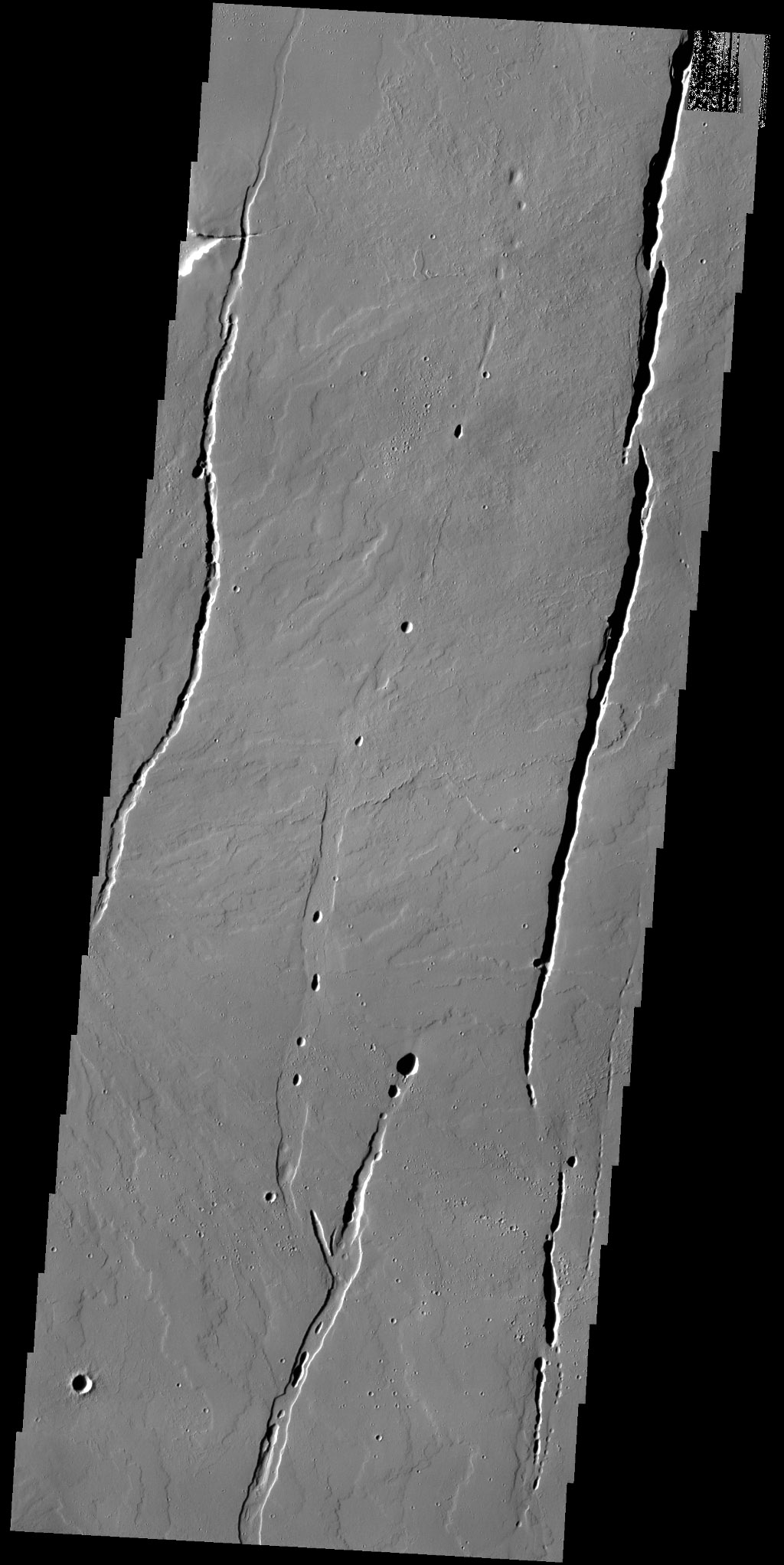 The lava flows and depressions in this image from NASA's 2001 Mars Odyssey spacecraft are located south of Alba Mons.