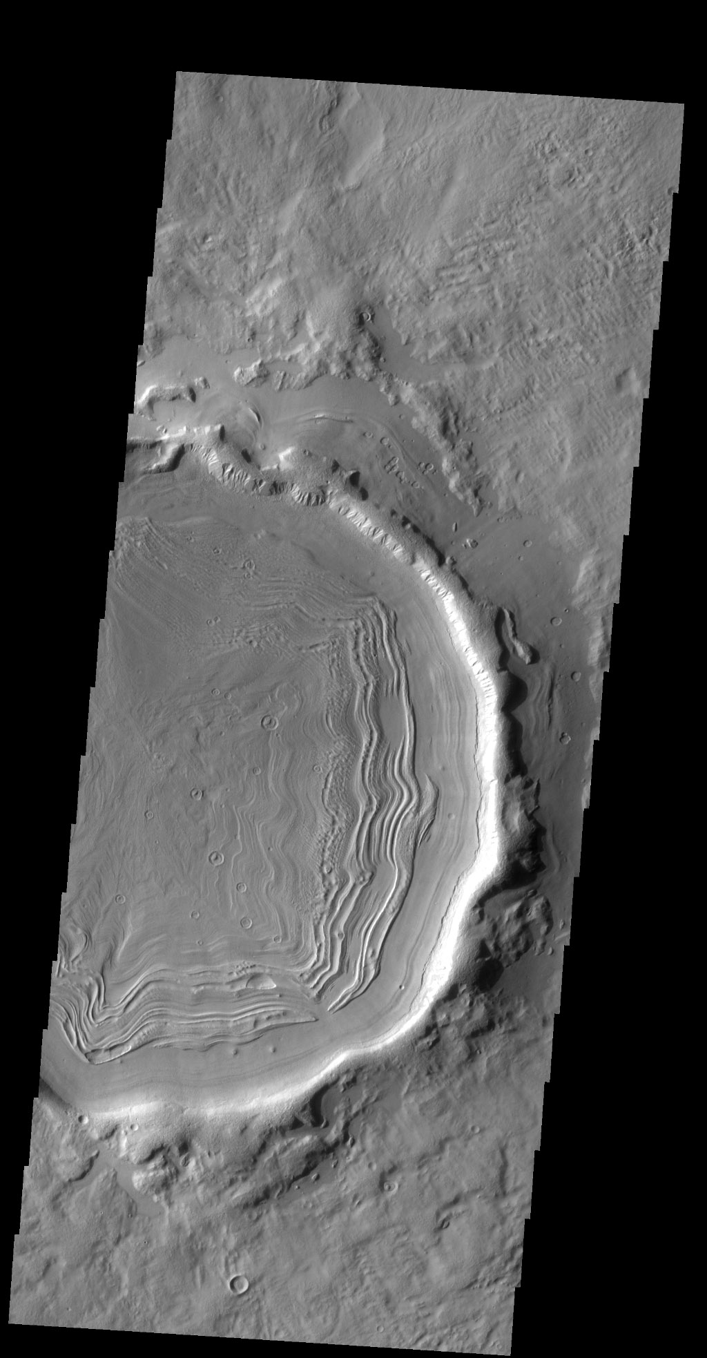 This unnamed crater in this image from NASA's 2001 Mars Odyssey spacecraft is located on the margin between Terra Sabaea and Utopia Planitia and is filled with material with a grooved surface.