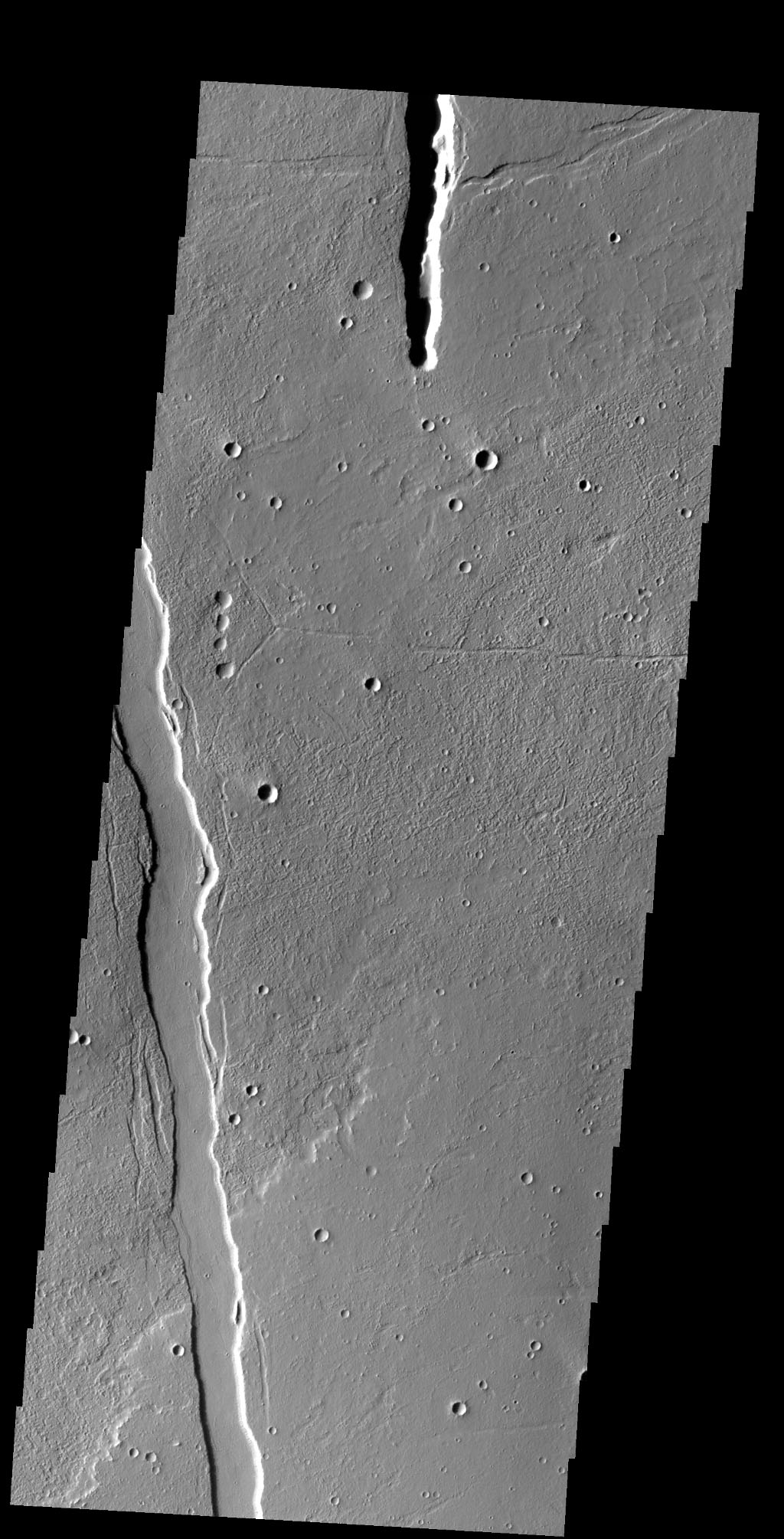 The linear depressions in this image from NASA's 2001 Mars Odyssey spacecraft are called graben. Graben are bounded on both sides by faults, and the central material has shifted downward between the faults.