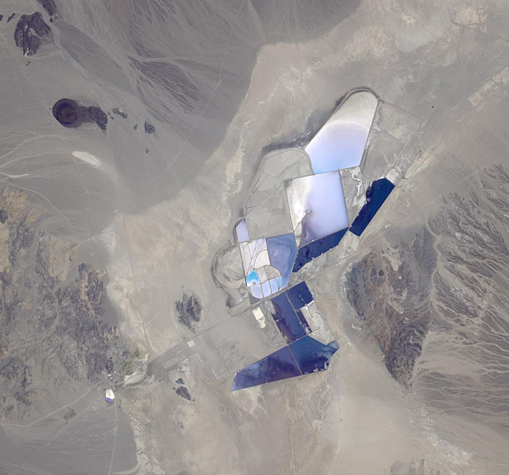 This image from NASA's Terra spacecraft shows the once-abandoned mining town of Silver Peak, Nevada, which began to thrive again when Foote Mineral Company began extracting lithium from brine below the floor of Clayton Valley in 1966.