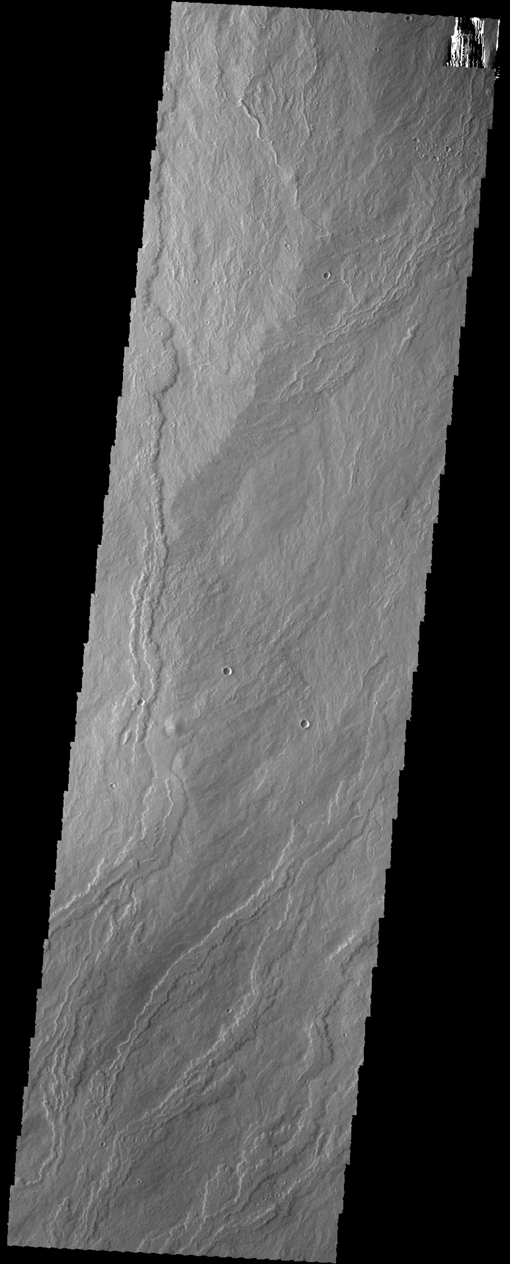 The lava flows in this image from NASA's 2001 Mars Odyssey spacecraft are part of Ascraeus Mons.