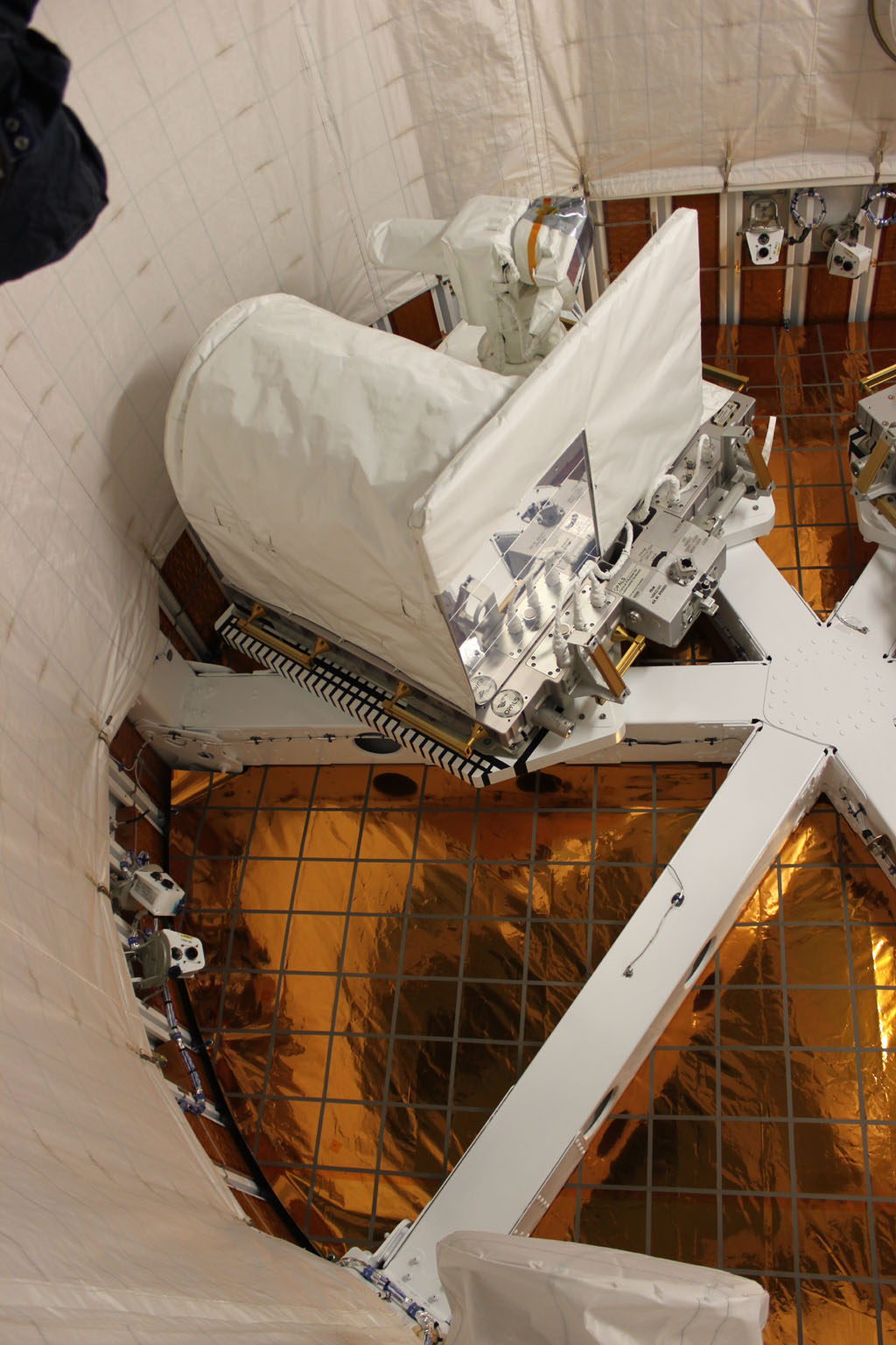This photo shows the Optical PAyload for Lasercomm Science (OPALS) being installed in SpaceX's Dragon capsule prior to launching on April 18, 2014.