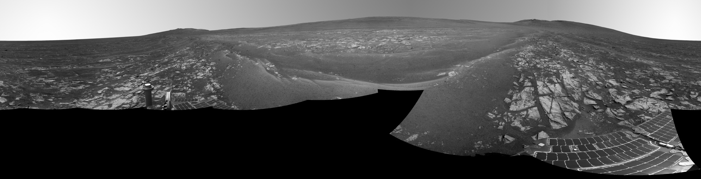 This July 29, 2014, panorama combines several images from the navigation camera on NASA's Mars Exploration Rover Opportunity to show the rover's surroundings after surpassing 25 miles (40.23 kilometers) of total driving on Mars.